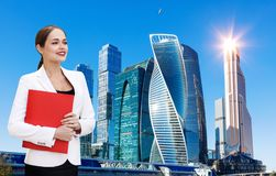 Business woman with clipboard over cityscape background. stock photos