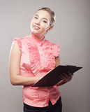 Business woman with clipboard Stock Images