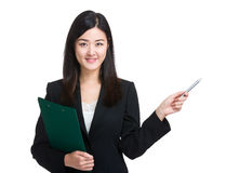 Business woman with clipboard and pen point out Stock Photos