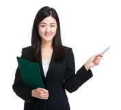 Business woman with clipboard and pen point up Royalty Free Stock Photography