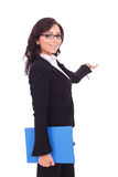 Business woman with clipboard presents Royalty Free Stock Photography