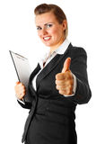 Business woman with clipboard showing thumbs up Royalty Free Stock Images