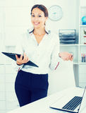 Business woman with clipboard Stock Photos