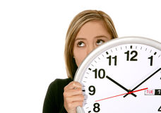 Business Woman with Clock. A pretty business woman hiding behind a clock Stock Image
