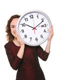 Business Woman with Clock. A pretty business woman hiding behind a clock Stock Photo
