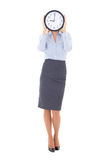 Business woman with clock covering face isolated on white Stock Photos
