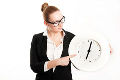 Business woman with  clock on  light background Stock Photography