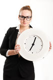Business woman with  clock on  light background Royalty Free Stock Image