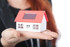 Business woman with close up of mini solar house. Young beautiful business woman with close up of mini solar house,isolated on white background Stock Images