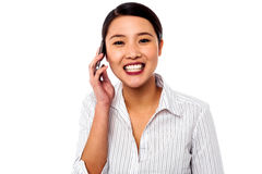 Business woman closing deal over a phone call Stock Image