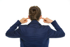 Business woman closing ears. rear view Royalty Free Stock Photo