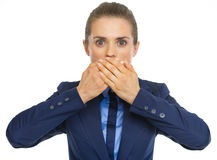 Business woman closing mouth Royalty Free Stock Images