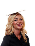 Business woman clowning around. A attractive blond haired business woman is clowning around with a clipboard on top of her head stock photo