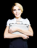 Business woman clutching a metal briefcase. Pretty blonde business woman clutching on tightly to a metal briefcase which she is guarding carefully as it contains Royalty Free Stock Photos