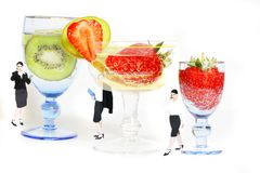 Business woman and cocktails. Young woman between big glasses of fruit cocktails with bubbles - business cocktail party metaphor stock photos