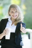 Business woman with coffee. Happy young business woman with coffee Royalty Free Stock Image