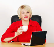 Business woman with coffee and laptop Royalty Free Stock Photography