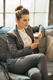 Business woman with coffee latte sitting on divan Royalty Free Stock Images