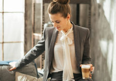 Business woman with coffee in loft apartment Stock Photo