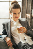Business woman with coffee relaxing in apartment Stock Photo