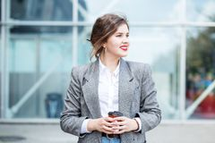 Business woman with coffee. Smiling girl. Copy space. Concept of lifestyle, urban, business, study. Business woman with coffee. Smiling girl. Copy space. Concept royalty free stock photo