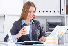Business woman with coffee at workplace Stock Photography