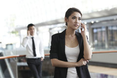 Business woman with colleague in the background Royalty Free Stock Image