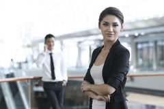 Business woman with colleague in the background Stock Images