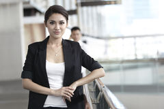 Business woman with colleague in the background Stock Image