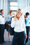 Business woman with colleagues at the back Stock Photography