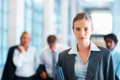 Business woman with colleagues at the background Royalty Free Stock Photo