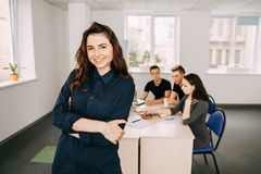 Business woman with colleagues meeting behind her royalty free stock images