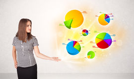 Business woman with colorful graphs and charts Stock Photography