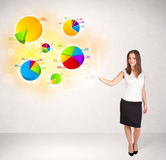 Business woman with colorful graphs and charts Stock Photo