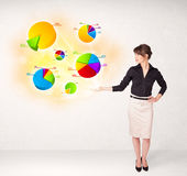 Business woman with colorful graphs and charts Royalty Free Stock Image