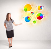 Business woman with colorful graphs and charts Royalty Free Stock Images
