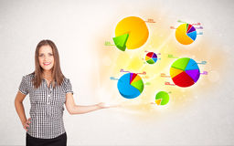 Business woman with colorful graphs and charts Stock Photos