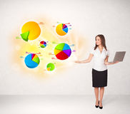 Business woman with colorful graphs and charts Stock Images