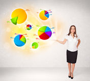 Business woman with colorful graphs and charts Stock Image