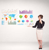 Business woman with colorful graphs and charts Royalty Free Stock Photography