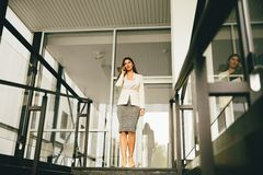 Business woman on stairs Royalty Free Stock Images