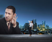 Business woman communicate with her partner using megaphone Stock Images