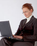 Business woman with computer Royalty Free Stock Image