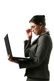Business woman with computer. Looking at the computer royalty free stock images