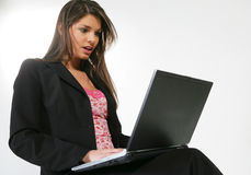 Business woman with a computer Royalty Free Stock Photos