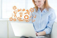 Business woman on computer with graph overlays. Digital composite of Business woman on computer with graph overlays Stock Image