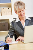 Business woman at computer taking Stock Images