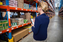 Business woman is concentrating during her work. In a warehouse stock photos