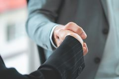 Business woman confidence handshake with partner. Business woman with confidence handshake with partner royalty free stock photo