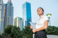 Business and woman. Confident businesswoman standing on a street Royalty Free Stock Image